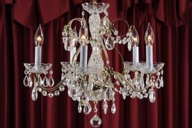 beautiful chandelier with dark red curtains in the background