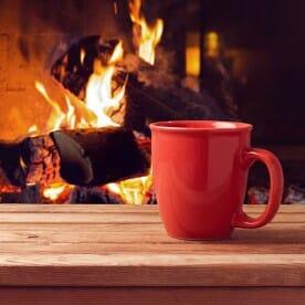 Fireplace and Red Coffee Mug