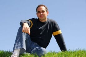 Man Sitting on Lawn