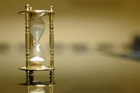 sand clock on a conference table