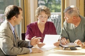 investment sales agent meeting with a senior couple