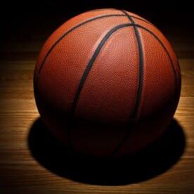 illuminated basketball on a wooden floor