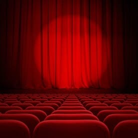Red Seats and Red Curtain in a Theater